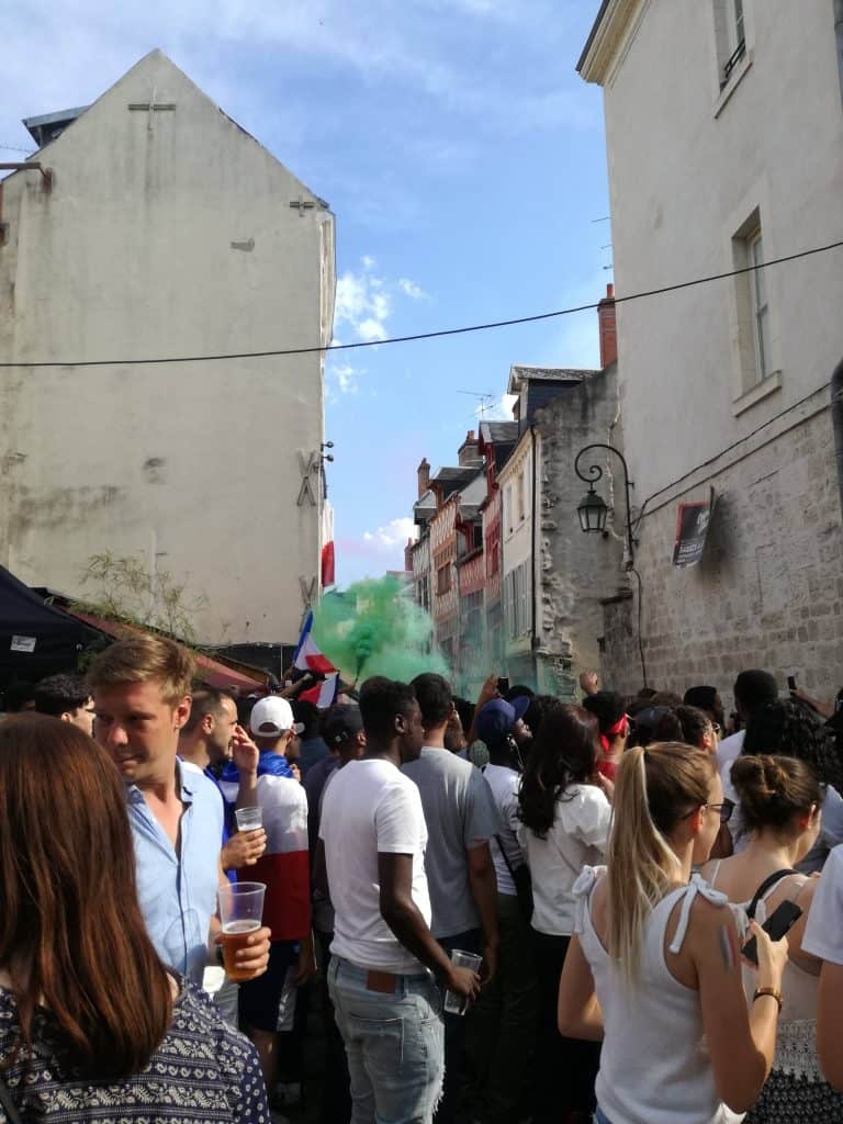 People watching the World Cup in the street