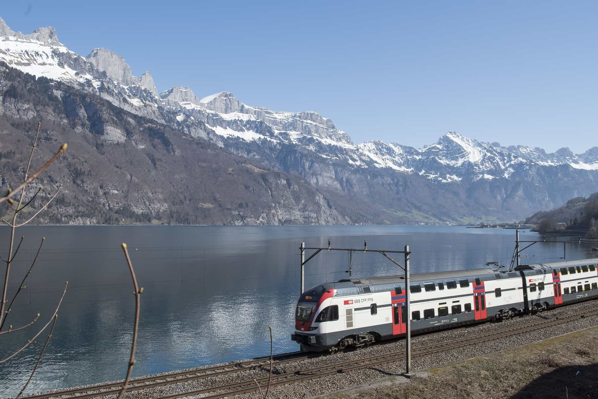 Train next to moutains in Switzerland