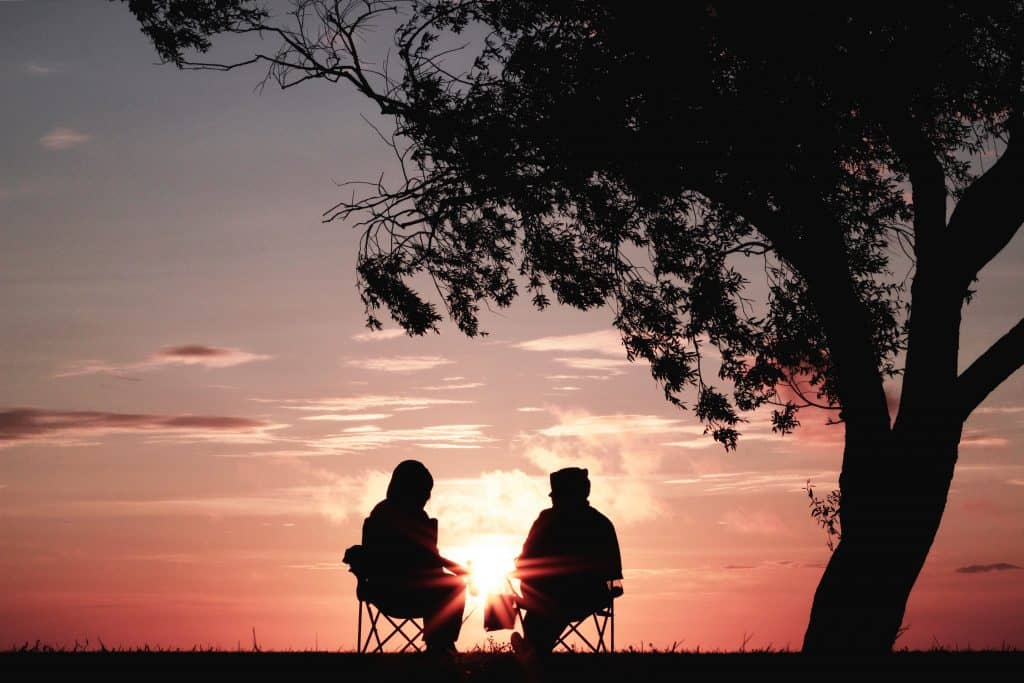 Retired couple watching the sunset