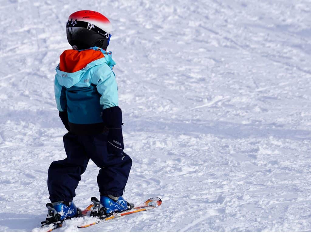 A young child learning to ski