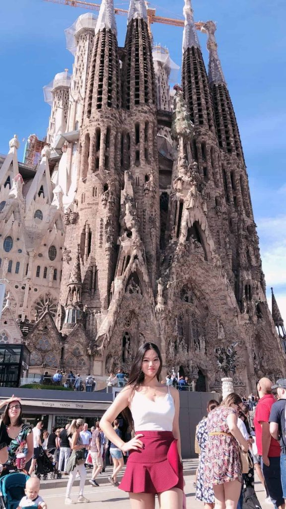 Mrs. The Poor Swiss in front of the Sagrada Familia